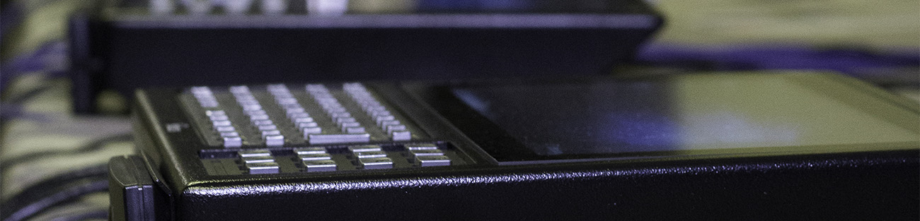 A close-up of the screen and keyboard of two Tempus Pros lying on their backs